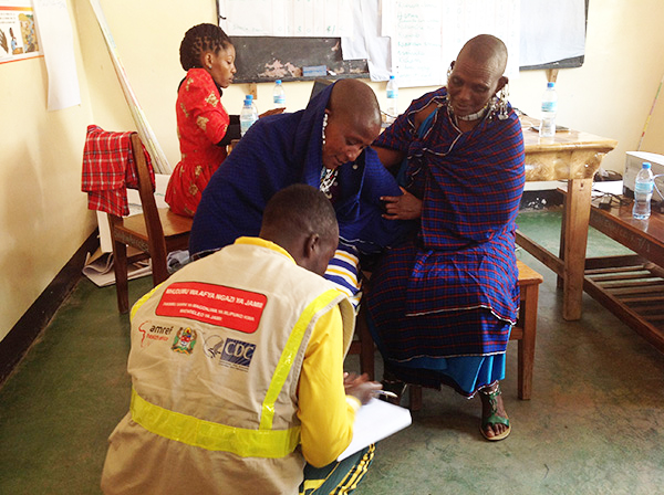 health workers helping someone