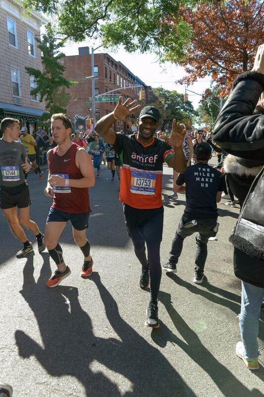 man running NYC Marathon