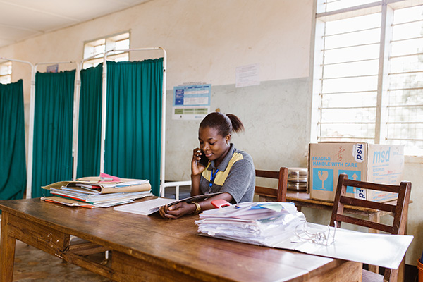 Health worker looking at patient records