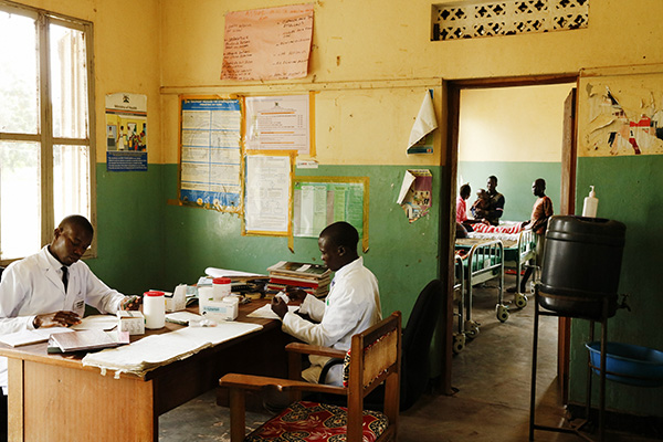 Two health workers at their desks